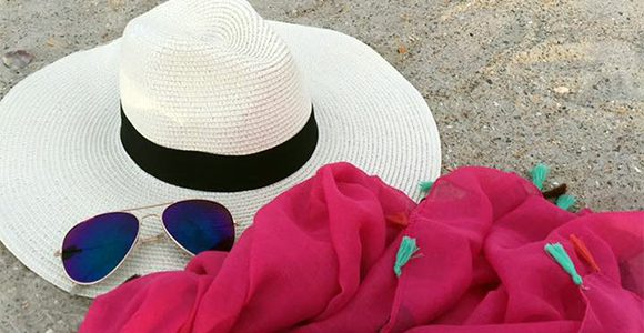 sunglasses, hat and scarf on the beach